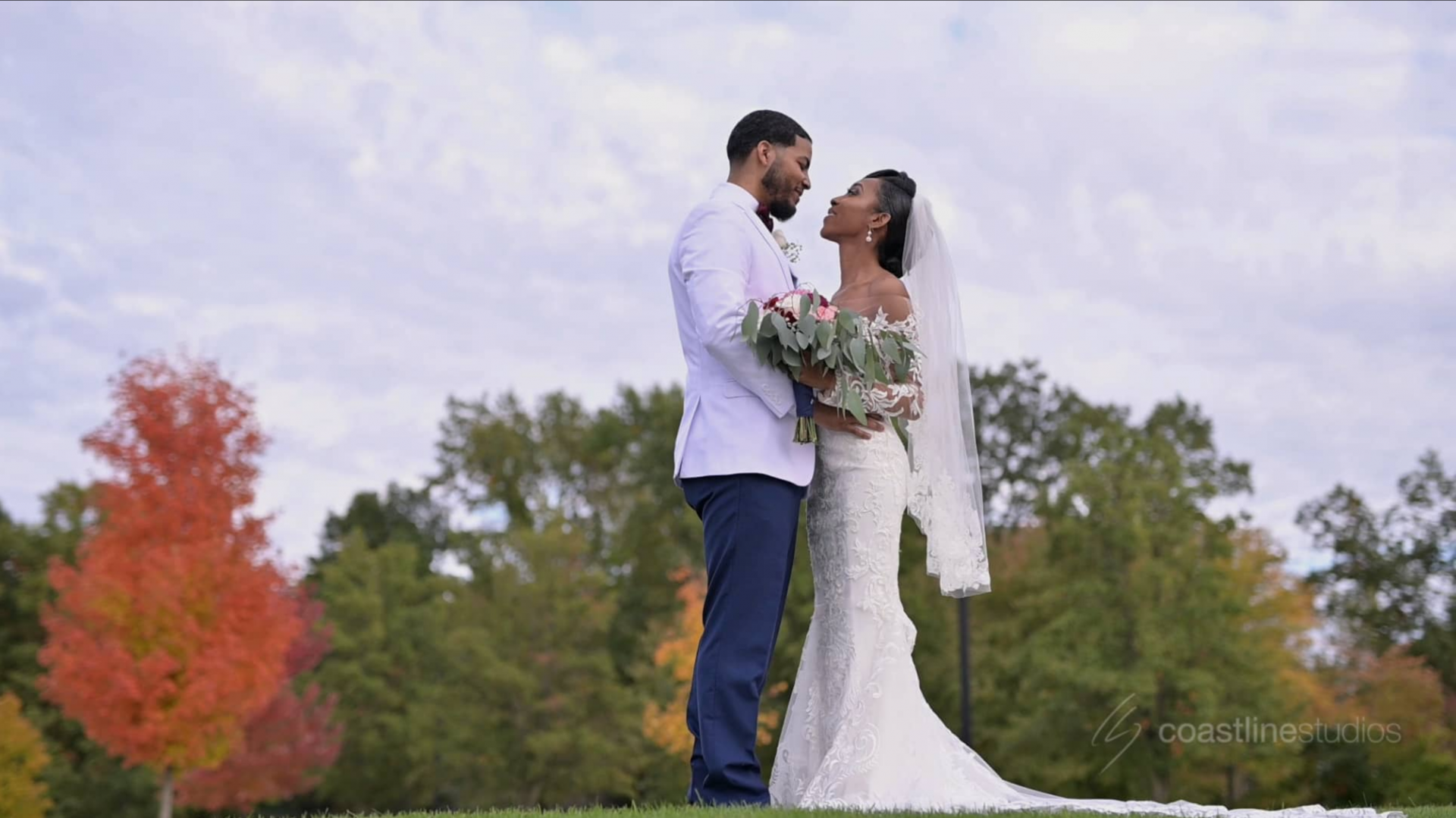 Jumping the Broom at Beautiful Fall Michigan Wedding